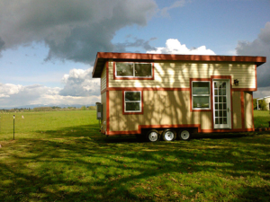 Tiny Smart House, Albany, Oregon, Willamette Farmhouse, Exterior, outside, triple-axle trailer, clouds, blue sky, grass