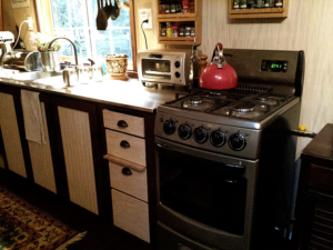 Tiny Smart House, Albany, Oregon, Willamette Farmhouse, kitchen, interior, stove, teapot, toaster oven, cabinets, window